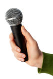 Holding a microphone. Isolated royalty free stock image