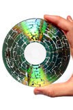 Holding a microwaved CD. With destroyed data Royalty Free Stock Photo