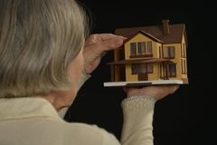 Holding miniature house Royalty Free Stock Photography