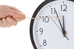 Holding minute hand alarm wall clock, business time management concept Stock Photo