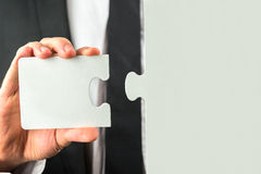 Holding a missing piece of a puzzle Royalty Free Stock Photography