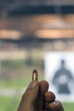 Holding 9mm bullet in hand Royalty Free Stock Photos