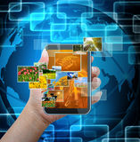 Holding mobile smart phone Stock Photo