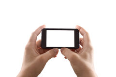 Holding mobile smartphone with blank screen Royalty Free Stock Image