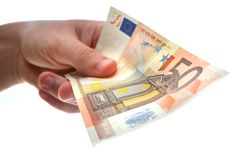 Holding money. A man holding europian money Royalty Free Stock Photography