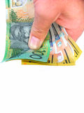 Holding money. Holding australian money stock photo