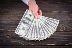 holding money dollars Royalty Free Stock Photos