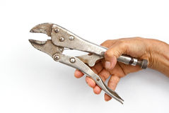 Holding monkey wrench in hand Royalty Free Stock Photo