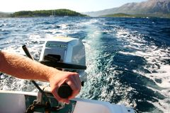 Holding motor on the boat Royalty Free Stock Photography