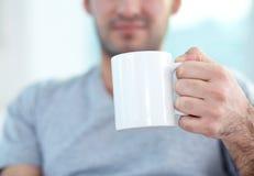 Holding mug Royalty Free Stock Image
