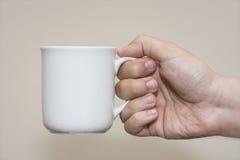 Holding A Mug Stock Photo