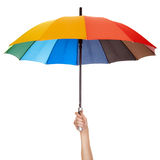 Holding multicolored umbrella isolated Royalty Free Stock Photography