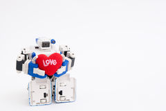 Holding my heart. A robot holding a heart Royalty Free Stock Photo