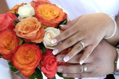 Holding my love. Bride and groom show off their rings Stock Image