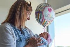 Holding new grandchild in hospital stock photos