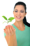 Holding New Life. Happy young woman holding new life in form of plant royalty free stock photo