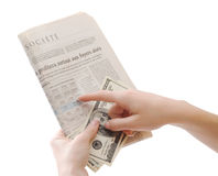 Holding newspaper and dollars Royalty Free Stock Photography