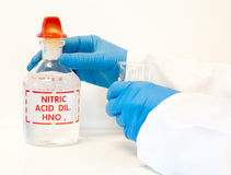 Holding nitric acid in the laboratory Stock Images