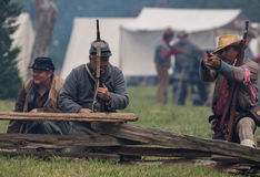 Holding off The Enemy. Civil War era soldiers in battle at the Dog Island reenactment in Red Bluff, California stock photography