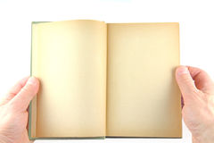 Holding an old book Royalty Free Stock Photos