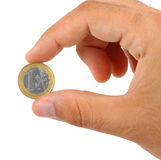 Holding one euro coin Royalty Free Stock Images