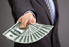 Holding one hundred dollar bills Royalty Free Stock Photography