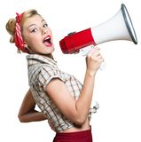 Portrait of woman holding megaphone, dressed in Stock Image