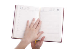 Holding opened notebook Stock Photo