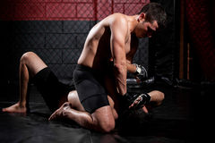 Holding an opponent down on a fight Stock Photos