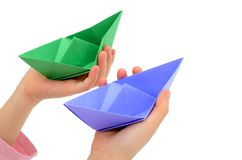 Holding origami boats Royalty Free Stock Photo
