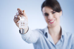 Holding out house keys Royalty Free Stock Image