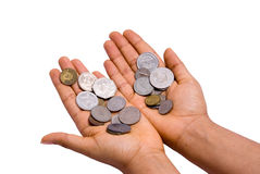 Holding out Middle Eastern coins Stock Image