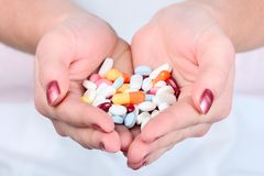 Holding out pills Royalty Free Stock Photography