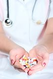 Holding out pills Stock Photos