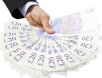 Holding Out Twenty Pound Notes Stock Photo