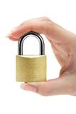 Holding a Padlock Stock Photo