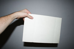 Holding paper for an ad Royalty Free Stock Photo