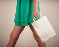 Holding paper bags Royalty Free Stock Image