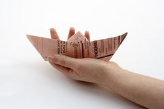 Holding a paper boat Stock Images