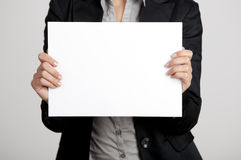 Holding a paper card Stock Images