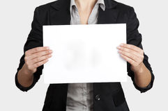 Holding a paper card Royalty Free Stock Photo