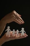Holding paper family Stock Photos