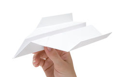 Holding a Paper Plane. Woman holding a folded plane. Isolated on a white background Royalty Free Stock Image