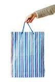 Holding paperbag Royalty Free Stock Photos
