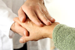 Holding patient hand Stock Photos