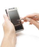 Holding pda and stylus. Woman hands holding pda and stylus, isolated, with clipping path Royalty Free Stock Photo