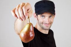 Holding a pear 3 Stock Photo