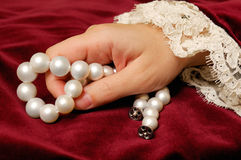 Holding a pearls necklace Stock Image