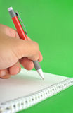 Holding a pen Stock Image