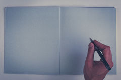 Holding pencil over blank page of a empty book Royalty Free Stock Photography